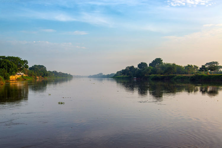 Early morning view of the Magdalena River in Mompox, Colombia Architecture Colombia Downtown Magda Mompos Mompox  UNESCO World Heritage Site View Building Colonial Heritage Historic Historical Landscape Magangue Old Port River Riverfront Southamerica Street Town Urban Water Waterfront