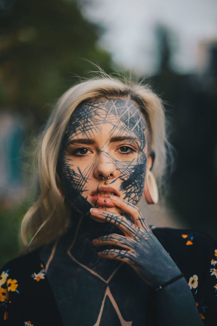 PORTRAIT OF WOMAN WITH MASK