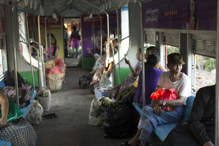 ASIA Burma Casual Clothing Commuter Commuters Commuting In The Train Inside The Train Looking Out Of The Window Myanmar On The Train On The Way On The Way Home People Poor People  Railway Rural Train Yangon Yangon Circular Railway Yangon, Myanmar Color Of Life Colours