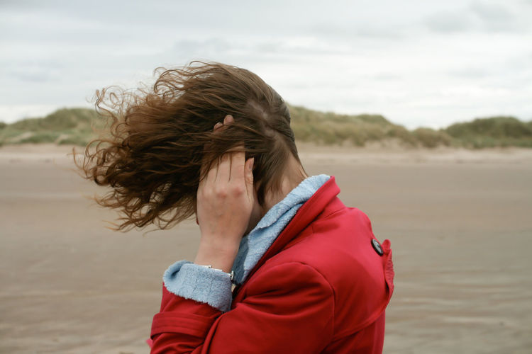 Windy Beach Beach Casual Clothing Cold Day Focus On Foreground Hair Hairstyle Land Leisure Activity Lifestyles Long Hair Nature One Person Outdoors Portrait Real People Sea Sky Tousled Hair Waist Up Water Wind Windy Windy Day Women