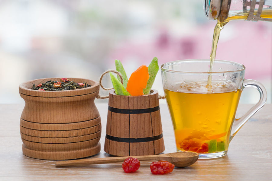 green tea and dried fruits on a wooden surface Cup Beverage Breakfast Detox Rustic Slim Tea Thirst Antioxidant Background Berry Blurred Background Blurry Dehydration Drink Dry Drying Fruits Fruit Green Tea Leaf Morning Rituals Rejuvenation Slimming Vegan Vitamin Wooden Tea Ceremony Mint Tea Herbal Tea Tea Leaves