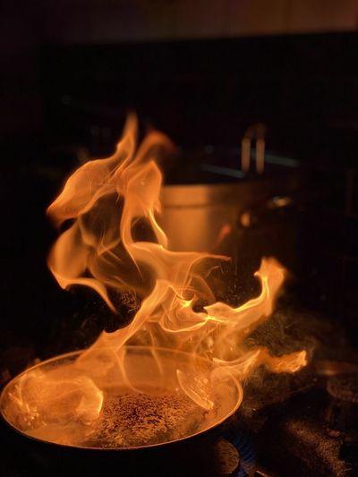 Close-up of fire in darkroom