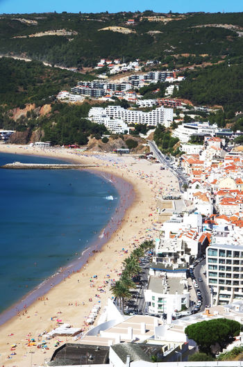 view on the coastal town of Sesimbra, Portugal Architecture Beach Building Building Exterior Built Structure City Cityscape Nature Outdoors Sea TOWNSCAPE Water