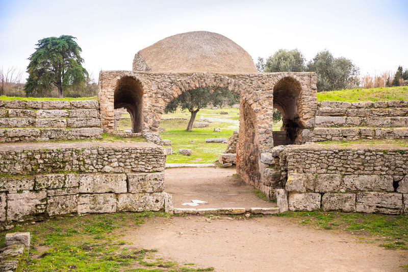 Italy Paestum Architecture History Built Structure Plant The Past Ancient Old Ruin No People Sky Nature Tree Day Wall Old Stone Material Stone Wall Grass Ancient Civilization Solid Arch Outdoors Ruined Archaeology