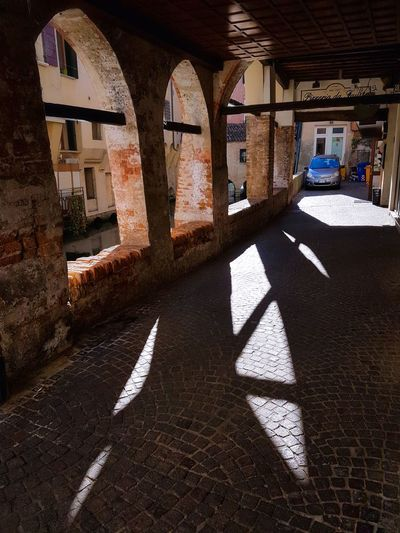 Light Flower Built Structure Architecture Shadow Day Sunlight Backlight Historical Buildings Paved Streets Red Brick Walls