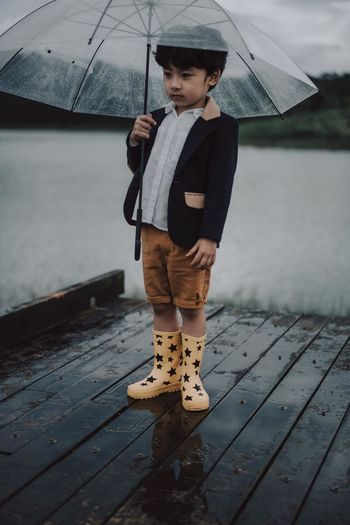 The Great Outdoors - 2018 EyeEm Awards Boys Casual Clothing Child Childhood Day Front View Full Length Innocence Leisure Activity Looking Males  Men One Person Outdoors Protection Rain Rainy Season Real People Standing Umbrella My Best Photo