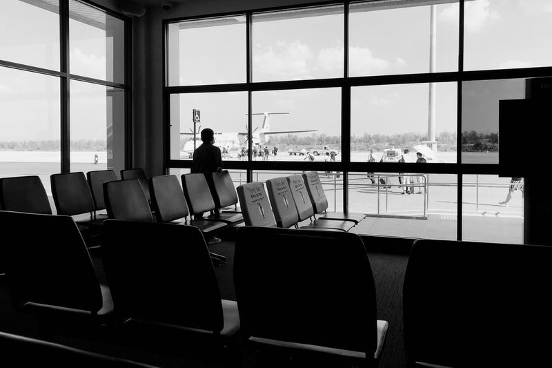 Man sitting on chair at airport