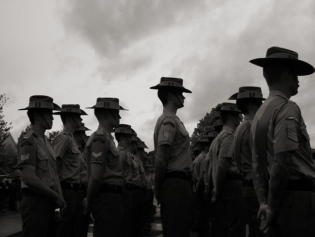 Anzac Day Army Soldier Black And White Photography Camouflage Clothing Day Large Group Of People Lestweforget Low Angle View Men Military Military Uniform Monochrome Outdoors Parade Time Paradise People Real People Rear View Responsibility Saluting Sky Streetphotography Uniform TCPM