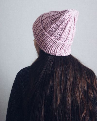 Rear view of woman wearing hat against white background