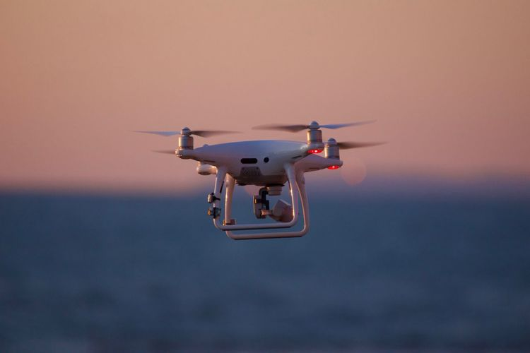 Air Vehicle Airplane Camera - Photographic Equipment Clear Sky Day Drone  Flying Media Equipment Mid-air Modern Motion Nature No People Outdoors Photography Themes Sea Sky Sunset Technology Transportation