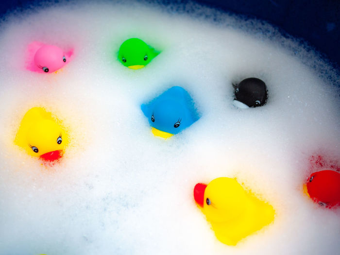 Ducks tales Multi Colored Yellow Toy Close-up Rubber Duck Creativity Water Floating On Water