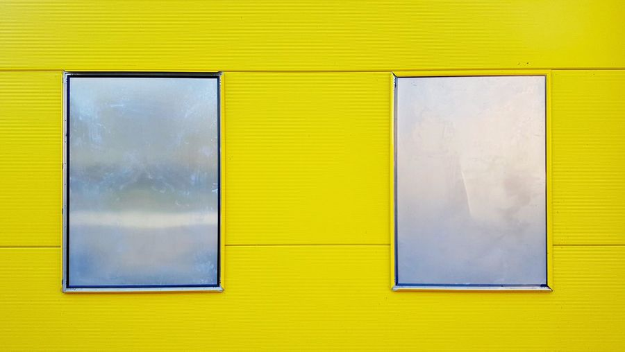Detail Shot Of A Yellow Wall And Tin Windows