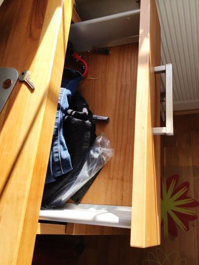 High angle view of shoes on wooden floor at home