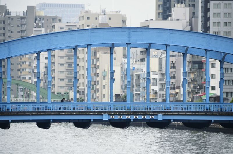 Metallic bridge over river in asakusa, japan