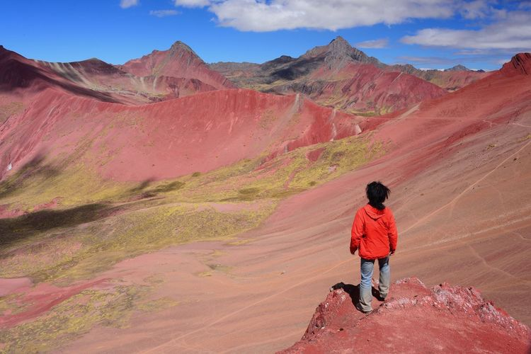 Red valley in rainbow mountain 3 hours away from Cusco, Peru Mountain Real People Beauty In Nature Scenics - Nature One Person Rear View Leisure Activity Landscape Sky Full Length Non-urban Scene Nature Mountain Range Environment Cloud - Sky Day Tranquility Casual Clothing Outdoors Mountains Mineral Red Cliff Young Adult Tourist