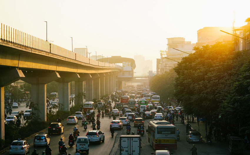 Traffic on road in city against clear sky