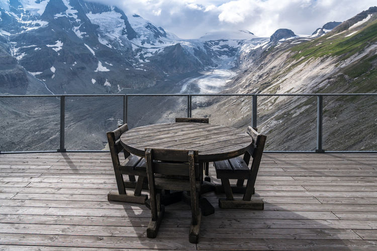 Chairs and tables on snow covered mountains