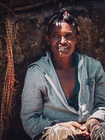 African Portraits Portrait Photography Portrait Of A Woman Africa Ethiopian Photography 🇪🇹 Ethiopian Ethiopia Front View Portrait One Person Looking At Camera Real People Smiling Lifestyles Adult Casual Clothing Leisure Activity Young Adult Waist Up Young Men Sitting Males  Mid Adult Happiness Wall - Building Feature