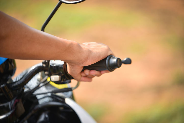 Close-up of man riding motorcycle