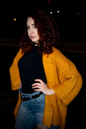 Portrait Of Young Woman Standing Outdoors At Night