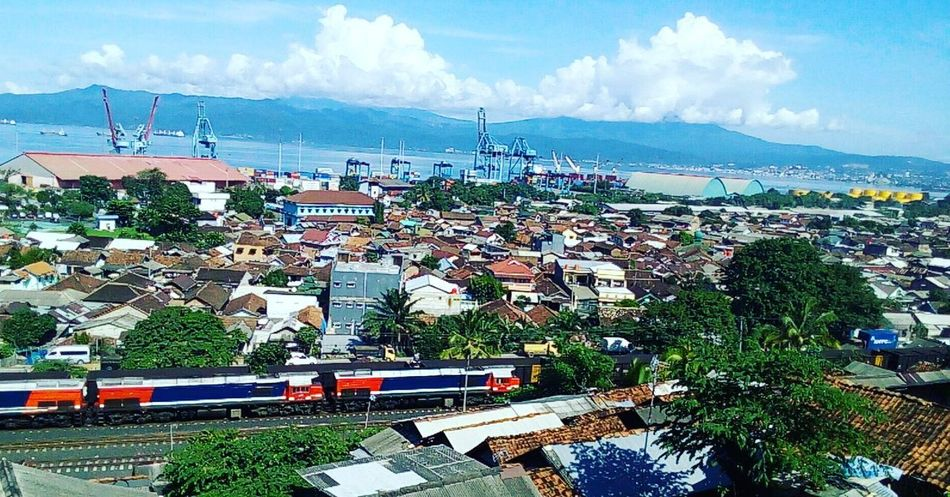 EyeEmNewHere High Angle View Outdoors Day Sea City Sky Cloud - Sky Architecture Building Exterior Aerial View Cityscape No People Horizon Over Water Urban Skyline Tree Cloud Mountain Train Journey Lampung INDONESIA Sun Sunlight Sunshine