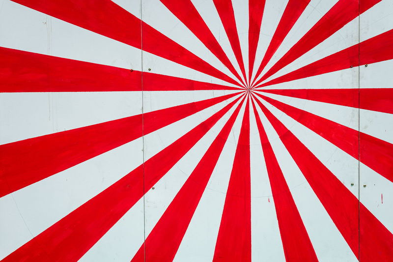 Low angle view of flag against white wall