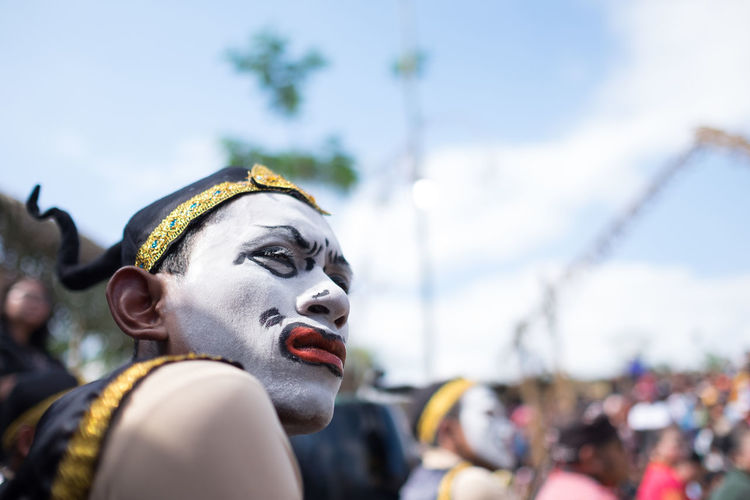 Magelang, Indonesia - June 24, 2016: Punakawan before performance at the Five Mountains Festival. The event was held to celebrate local art and culture. Art And Craft Arts Culture And Entertainment Day Festival Focus On Foreground Group Of People Headshot Human Representation Incidental People Low Angle View Male Likeness Nature Outdoors People Portrait Representation Sculpture Selective Focus Sky Statue Uniform