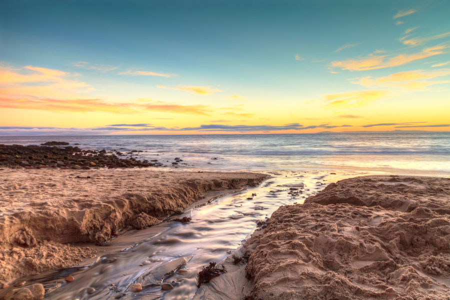 Little Corona Beach in Corona Del Mar, California at sunset in summer Beach Beauty In Nature California Coastline Corona Del Mar Landscape Little Corona Beach Nature Ocean Outdoors Rocks Sea Sea And Sky Seascape Sky And Clouds Sunset Sunsets