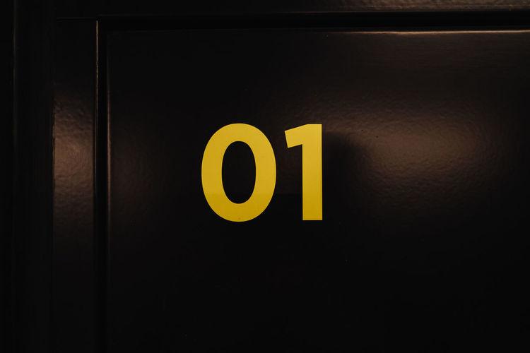 Close-up of number 1 on black door