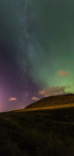 Astronomy Aurora Beauty In Nature Field Grass Green Color Iceland Landscape Nature Night No People Outdoors Scenics Sky Tranquil Scene