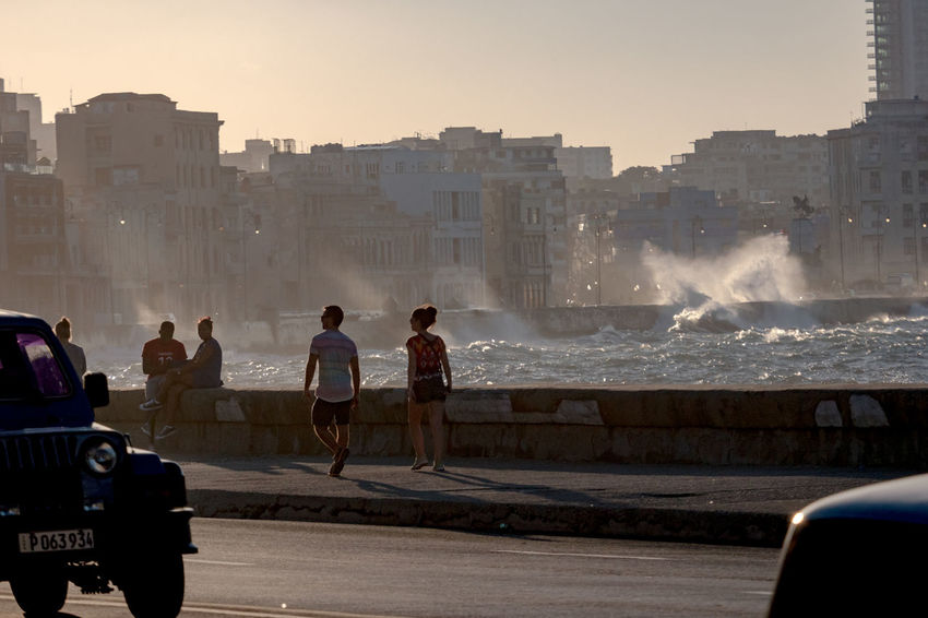 Malecon, November 2016 Before Sunset Coastline Architecture Building Exterior Built Structure City Clear Sky Day Evening Malecón, La Habana Men Motion Nature Outdoors People Real People Sea Sky Splashing Waves Sunlight Sunset Women