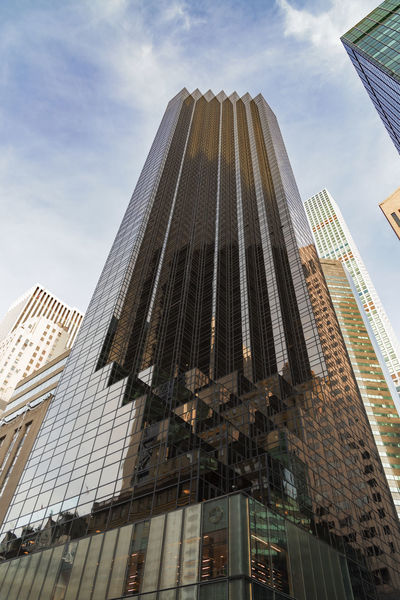 Looking up at the Trump tower in New York City. Charlatan New York City Putin Architecture Building Exterior Built Structure City Cityscape Conman Corporate Business Day Fraud Low Angle View Modern No People Office Building Exterior Outdoors Sky Skyscraper Tall Tall - High Tower Travel Destinations Trump
