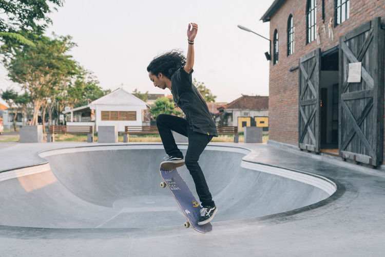 Skateboarding Architecture Building Exterior Built Structure Casual Clothing Day Energetic Full Length Fun Jumping Leisure Activity Lifestyles Mid-air Motion One Person Outdoors People Real People Skate Skateboard Skateboard Park Skill  Stunt Young Adult Done That.