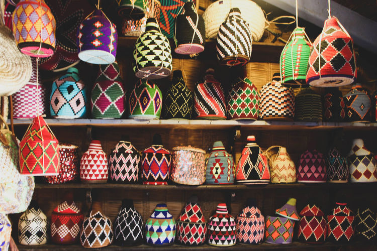 Colorful decorations on shelf for sale in store