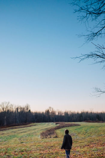Bare Tree Beauty In Nature Clear Sky Day Field Full Length Landscape Lifestyles Men Nature One Person Outdoors People Real People Rear View Scenics Sky Tranquil Scene Tranquility Tree
