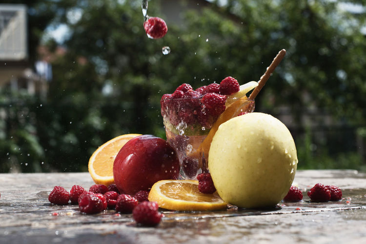 Close-up of fruits splashed with water