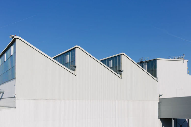 Exterior of built structure against clear blue sky