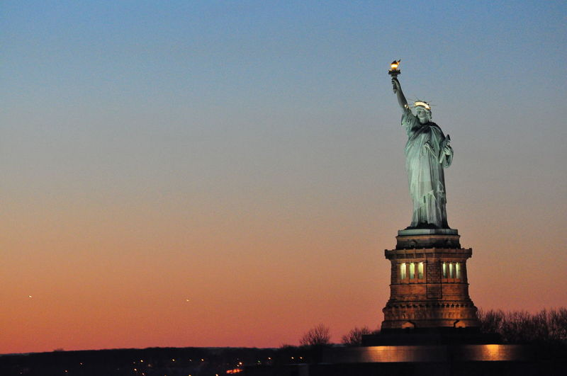Architecture City Cloud - Sky Cultures Day Flaming Torch Freedom Monument Nature New York City No People Outdoors Patriotism Sculpture Sea Sky Statue Statue Of Liberty Sunset Travel Travel Destinations Urban Skyline Water