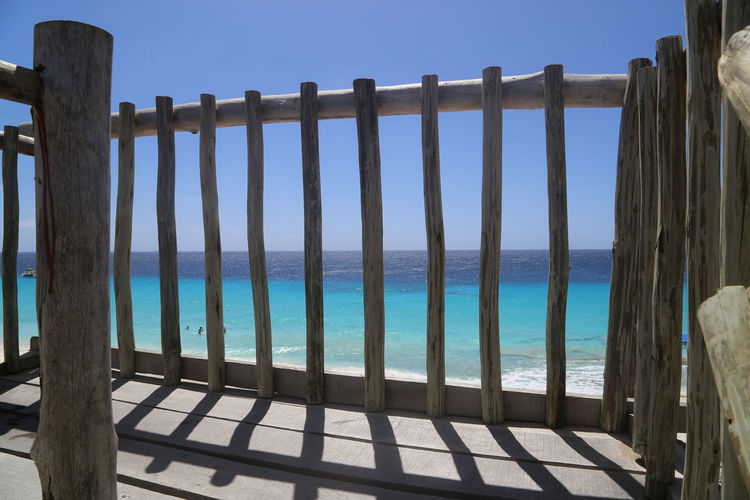 Beach Blue Caribbean Caribbean Sea Curacao Fence Horizon Over Water Klein Curacao Outdoors Sea Seascape Sky Sunny Tranquil Scene Tranquility Water Wooden