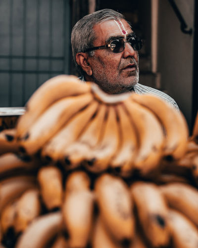 Banana necklace Streetphotography Streetphotography The Street Photographer - 2019 EyeEm Awards Gray Hair Beard Portrait Eyeglasses  City Warm Clothing Mature Men Close-up