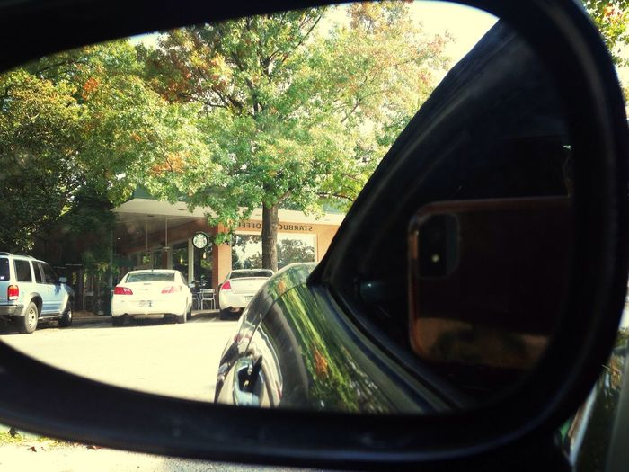 The Side Mirror View Of Starbucks!!