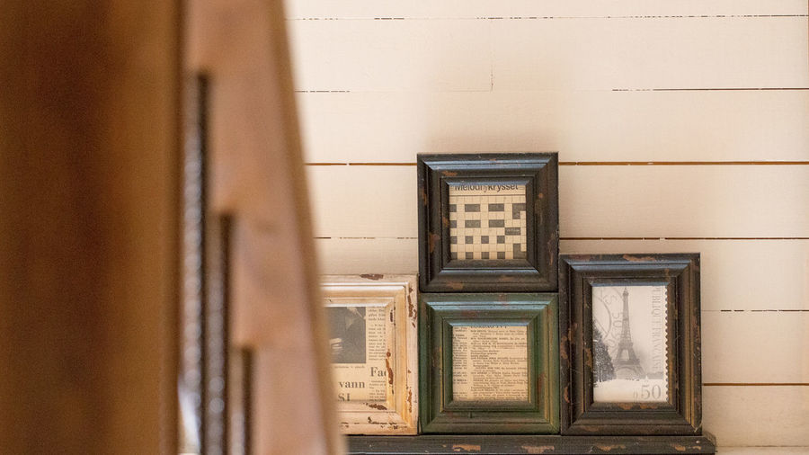 Wooden wall with framed pictures
