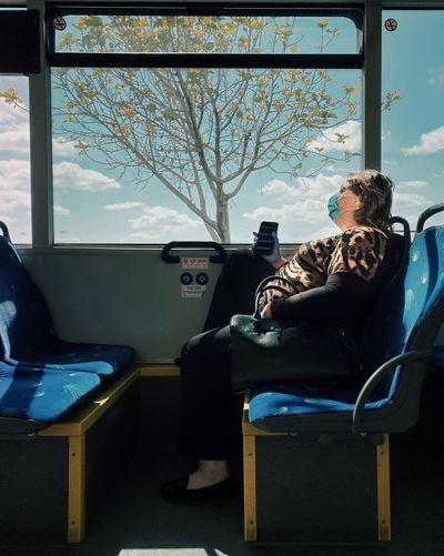 People sitting on chair in bus
