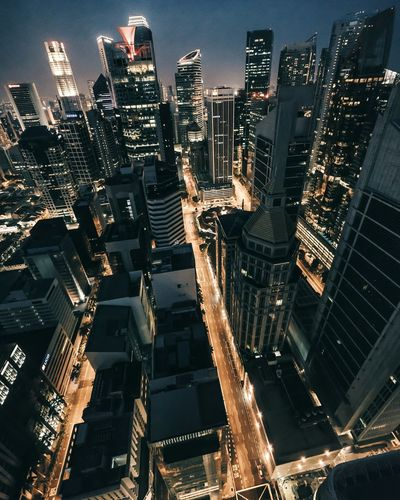City Cityscape Night Illuminated Skyscraper Urban Skyline Outdoors Financial District  Travel Destinations City Life Office Building Exterior Architecture Business Finance And Industry Building Exterior Downtown District Aerial View Modern Urban Road People Sky
