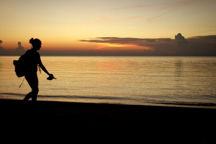 Sunset Water Sea Horizon Over Water Scenics Beach Tranquil Scene Full Length Silhouette Beauty In Nature Shore Tranquility Orange Color Sky Vacations Person Thailand_allshots People In Places AMPt_community Eye4photography  EyeEm Best Shots Sunset Silhouettes People And Places
