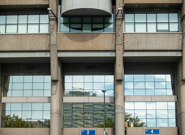 Architecture EyeEm Best Shots EyeEmNewHere Football Geometric Architecture Santiago Bernabéu Stadium Sport In The City Stadium Teamwork Urban Lifestyle Architectural Column Architectural Feature Architecture Building Building Exterior Built Structure Business City City Life Cooperation Day First Eyeem Photo Geometric Abstraction Glass - Material Glass Reflection Individuality Industry Lifestyles Low Angle View Modern No People Office Office Building Exterior Outdoors Reflection Santiago Bernabeu Sport Sport Building Still Life Team Team Sport Window Window Reflections