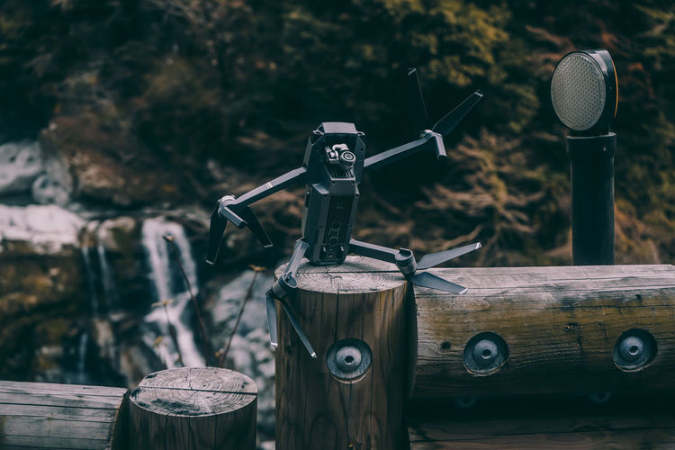 // chilling by the waterfall // Drone  Fun Funny Hilarious AMPt_community Focus On Foreground Wood - Material Metal No People Close-up Day Equipment Technology Outdoors Nature Old Still Life Wood Retro Styled Communication Machinery Sunlight High Angle View Land Nature Humanity Meets Technology