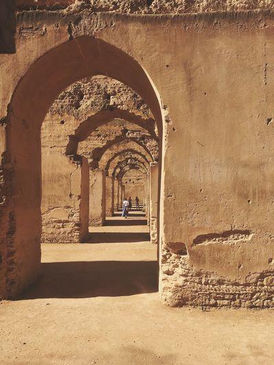 Women in corridor of old building