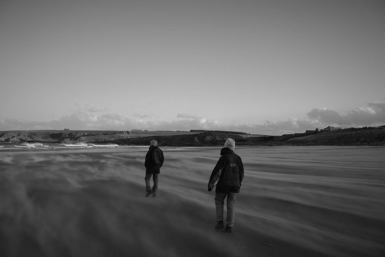 Beach Black And White Cold Temperature Day Full Length Outdoors People Real People Rear View Sandstorm Schwarzweiß Sea Sky Togetherness Two Figures Two People Walking Walking Around Walking Away Warm Clothing Windswept Winter