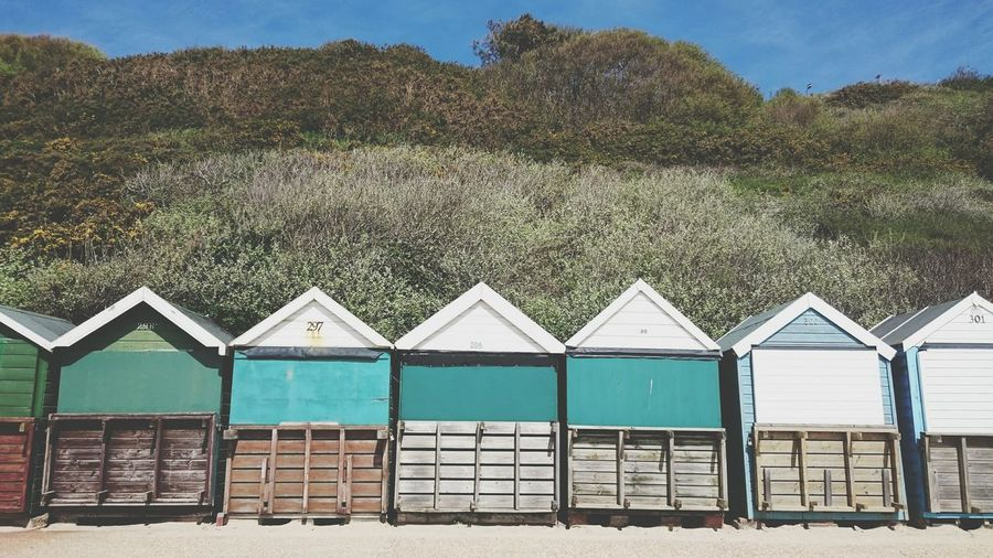 Funny beach huts in Bournemouth . Beach Huts Colourful Houses Turquoise Petrol Outdoors No People Holiday Green Color Green Eye4photography  Pattern Wooden Beach Life